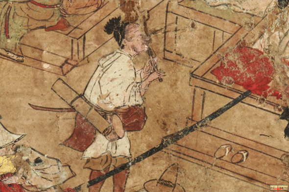 Komosō playing the hitoyogiri in a street, close-up